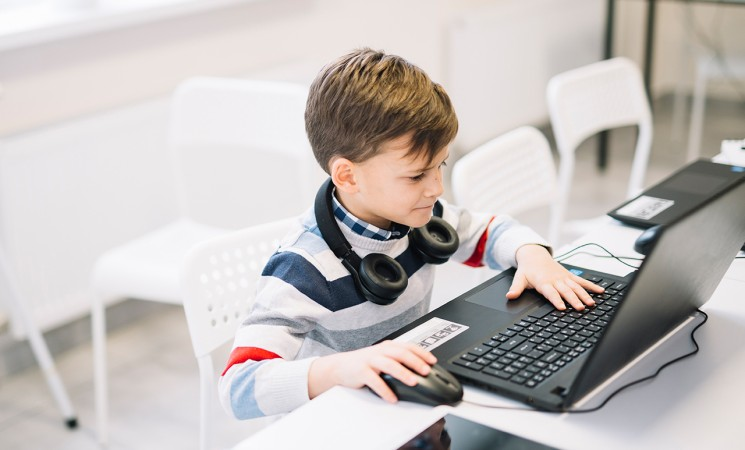 https://campaign-image.in/zohocampaigns/little-boy-using-laptop-desk-classroom-745x450_zc_v8_6_12093000012769196.jpg
